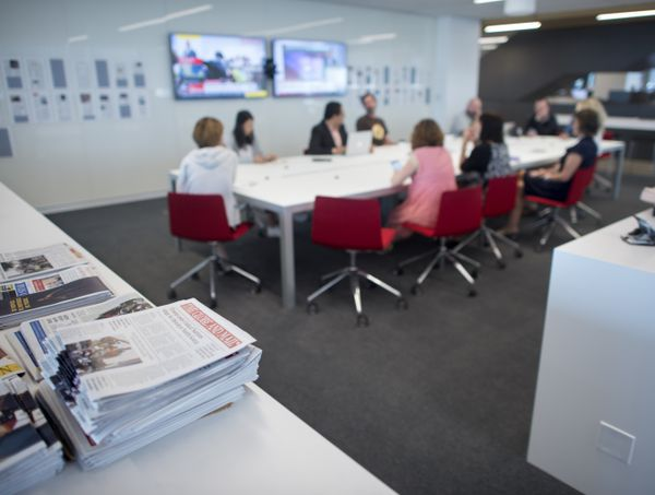 Writes and editors and general scenes of the Globe and Mail newsroom at 351 King St. East, are photographed on Sept 20 2017. (Fred Lum/The Globe and Mail)